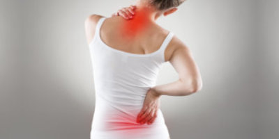 woman suffering back and neck pain